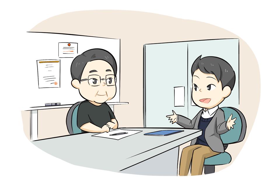 キャリアアドバイザーと面談する50代男性