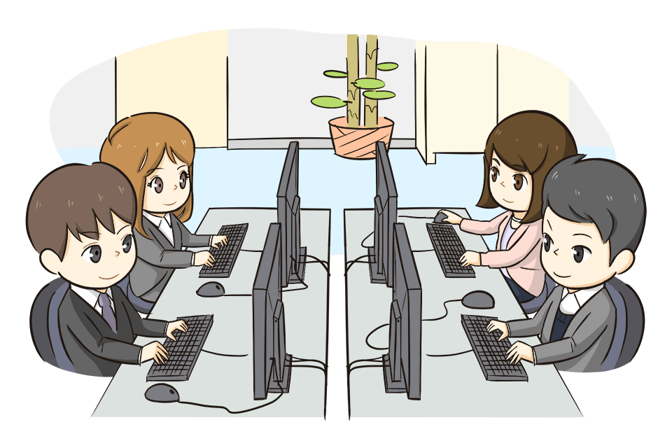 パソコンに向かって仕事をしているIT業界の男女